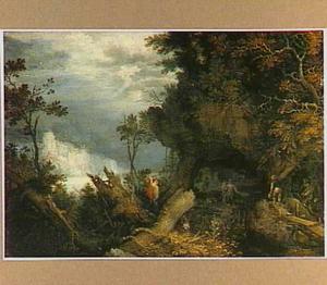 Boslandschap met een houthakker; op de achtergrond werklieden in een grot