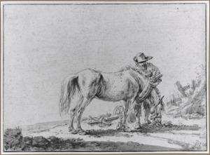 Een boer ontdoet zijn ploegpaard van het gareel