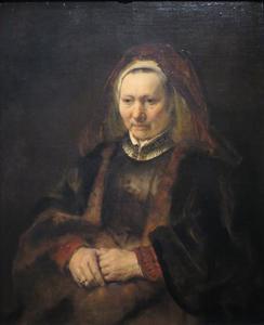 Zittende oudere vrouw
