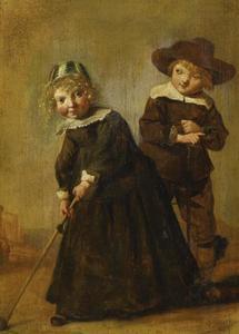 Een jongetje en een meisje bij het kolfspel