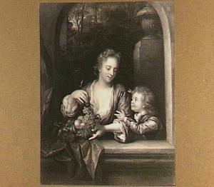 Een vrouw met vruchten en een jongetje in een venster