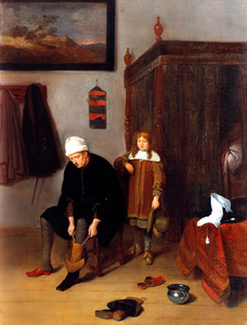 Interieur met een jongen en een man die zijn laars aantrekt