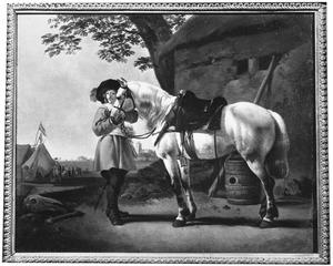 Landschap met een paard en een ruiter bij een legerkamp