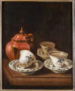 Een Yixing theepot, porseleinen kopjes en schoteltjes
