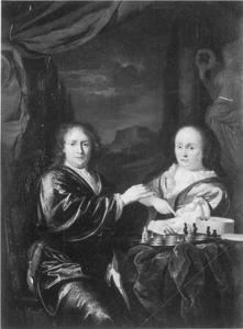 een heer en dame bij een schaakspel