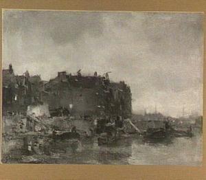 Huizen aan de Prins Hendrikkade te Amsterdam op een mistige dag