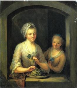 Vrouw en meisje in een venster
