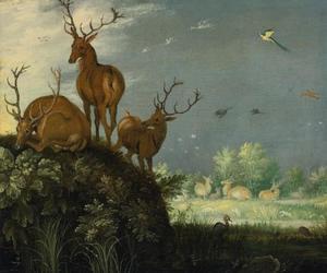 Landschap met rustende herten op een heuvel