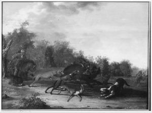 Landschap met een Oosters geklede ruiter en honden jagend op een everzwijn