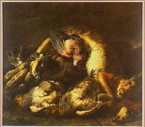 Kat bij een jachtbuit van vogels en een haas
