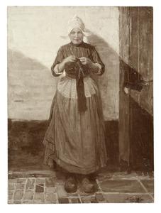 Vrouw in klederdracht aan het breien