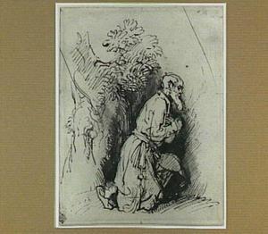 Knielende man in een landschap
