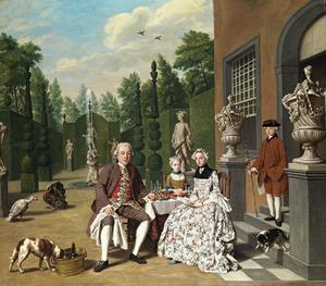 Portret van een onbekende familie in de tuin
