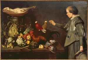 Keukenstuk met een jongen en levende vogels
