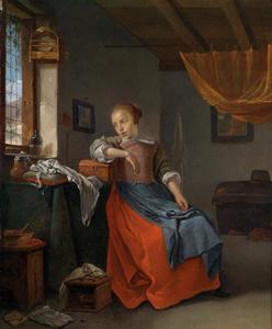 Interieur met een vrouw aan de naaitafel