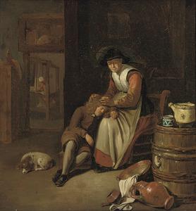 Interieur met een vrouw die een jongen luist
