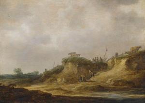 Duinlandschap met een landweg met herders