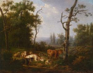 Rustend vee in een boslandschap