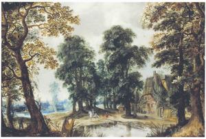 Landschap met enkele huizen tussen bomen