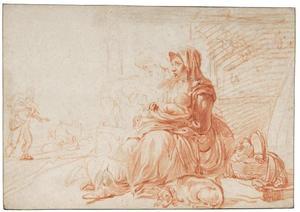 Moeder met kind zittend in een landschap
