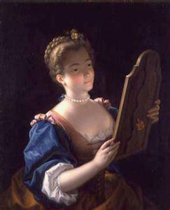 Jonge vrouw voor de spiegel