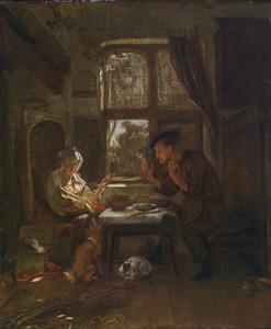 Familie aan tafel in een interieur