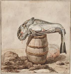 Dode kabeljauw liggend op een ton