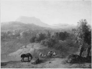 Weids heuvellandschap met rustende herders en enkele dieren