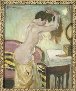 Jonge vrouw bij een kaptafel