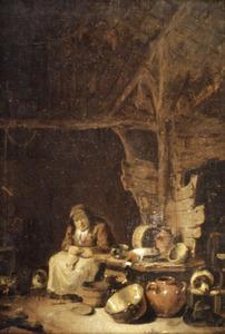 Interieur met zittende vrouw in een keuken