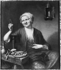 Vrouw met een bierglas in de hand