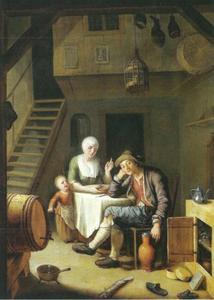 Huiselijk tafereeel van een man, een vrouw en een kind bij de maaltijd