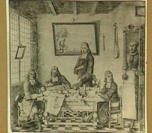 Interieur met tekenaars en prentmakers rond een tafel
