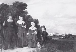 Portret van een familie in een duinlandschap