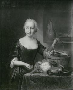 Huisvrouw met keukengerei
