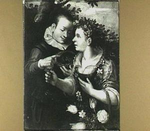 Een jongen met een vogelnestje en een jong meisje met bloemen in een korfje: de Lente (?)