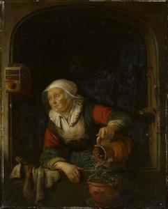 Oude vrouw die een potplant begiet