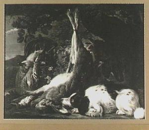 Twee honden bij een jachtbuit van haas en gevogelte in een mand