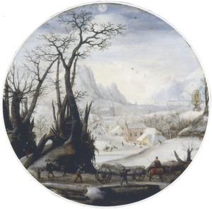 De maand december: winterlandschap met in de voorgrond een kar met boomstammen