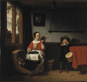 Jonge vrouw met een roede bij een wieg en een jongen met een trommel