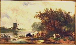 Landschap met koeien aan een plas