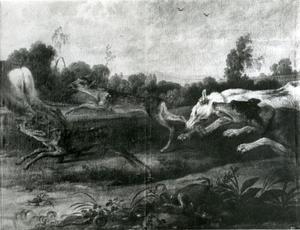 Honden vallen een groepje jonge herten aan
