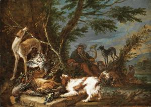 Honden en jager bij jachtbuit in een landschap