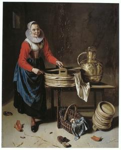 Een keukenmeid bij enig keukengerei