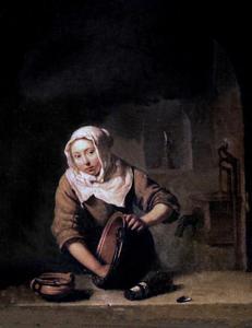 Jonge vrouw, een ketel schrobbend