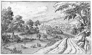 Heuvelachtig landschap met landweg naar een dorp