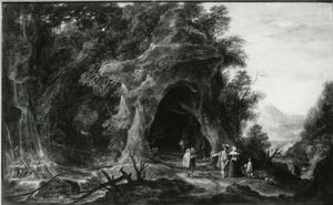 Boslandschap met een kapel in een grot