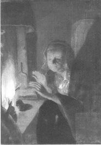 Vrouw bij een open haard