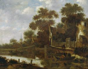 Dorpsgezicht met bootjes in een kanaal
