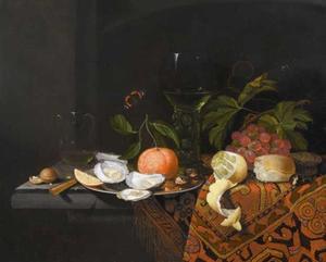 Stilleven met roemer, vruchten, oesters, citroen en brood op een oosters kleed